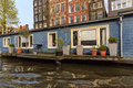 Houseboat with terace in Amsterdam Royalty Free Stock Photo