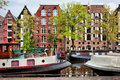 Houseboats and houses on brouwersgracht canal in amsterdam old warehouses converted to apartments blocks along the brewers Royalty Free Stock Image