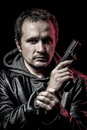 Housebreaker, thief, armed man with black leather jacket, danger Royalty Free Stock Photo