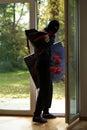 Housebreaker wearing a mask loking through the window Royalty Free Stock Photos