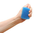 Household sponge in a hand Royalty Free Stock Photography