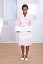 Housekeeper carrying towels in hotel smiling young female Royalty Free Stock Image