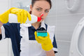 Housekeeper pouring detergent onto a sponge Royalty Free Stock Photo