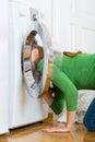 Housekeeper with washing machine Royalty Free Stock Photo