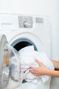 Housekeeper with washing machine Royalty Free Stock Photo