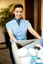 Housekeeping executive pushing the cart Royalty Free Stock Images