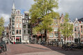 Houses of amsterdam traditional dutch style terraced and bridge on oudezijds voorburgwal canal city the netherlands Royalty Free Stock Images