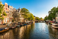 Houses and Boats on Amsterdam Canal Royalty Free Stock Photo