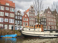 Houses and boats on the canal in amsterdam netherlands Royalty Free Stock Photos