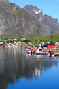 Houses boats and mounts of reine in lofoten the village for the times magazine the most beautiful place the world Stock Photos