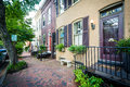 Houses and brick sidewalk in the Old Town of Alexandria, Virginia. Royalty Free Stock Photo
