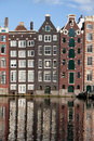 Houses on canal in amsterdam netherland traditional dutch style row a with reflections water holland netherlands Stock Photography