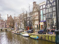 Houses on the canal in amsterdam netherlands february city landscape Royalty Free Stock Photos