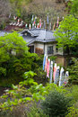 Houses decorated with carp streamers hanging between to celebrate children s day in kurokawa onsen japan Stock Image