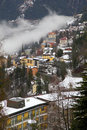 Houses and fog in alps mountain resort village bad gastein austria s austrian vertical view above Stock Photos