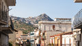 Houses in Giardini Naxos and view of Taormina city Royalty Free Stock Photo