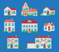 Houses icons set real estate in cartoon style on blue background Stock Images