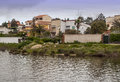 Houses on the lake shore in swamp of proserpina in spanish city of merida ii s a cloudy day Royalty Free Stock Photo