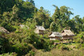Houses in Laotian Jungle Royalty Free Stock Image