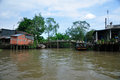 Houses in the mekong river delta and a bridge near vinh long vietnam Stock Photography