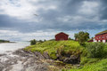 Houses near the sea with lowtide norway horziontal shot Royalty Free Stock Image