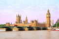 Houses of parliament and big ben tower with westminster bridge v red buses view Stock Photos