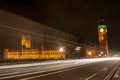 Houses of parliament at night trails in london street near big ben Royalty Free Stock Photos