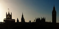 Houses of parliament skyline in silhouette cityscape at sunset including big ben and the london england Royalty Free Stock Photos