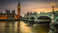 Houses of parliament at sunset and big ben beside the river thames and westminster bridge london Stock Photos