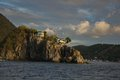Houses on a rock built rocky headland Stock Image