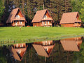 Houses on the shore bank of pond reflection Stock Image