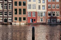 Houses on water in amsterdam netherland traditional dutch style historical row a cana holland netherlands Stock Images