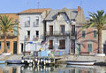 Houses on waterfront, Le-Grau-du-Roi Stock Photos