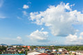 Housetop view on blue sky with big clouds and free space for your text Stock Photography