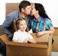 Housewarming photo of a young family with a boxes Stock Photos