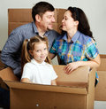 Housewarming photo of a young family with a boxes Stock Photo