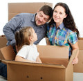 Housewarming photo of a young family with a boxes Stock Images