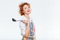 Housewife in apron holding soup ladle Royalty Free Stock Photo