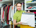 Housewife arranging clothes at wardrobe orderly happy indoor Stock Photo