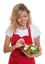 Housewife with blonde hair preparing her salad Royalty Free Stock Photo