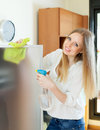Housewife cleaning glass positive blonde Royalty Free Stock Photo