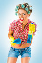 Housewife with cleaning product blue background Stock Photography