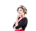 Housewife with curlers portrait over white background Royalty Free Stock Photography