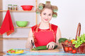 Housewife cutting cucumber in the kitchen Royalty Free Stock Images
