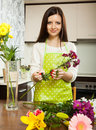 Housewife doing  bouquet on   table Royalty Free Stock Photo