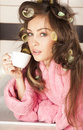 Housewife drinking coffee Stock Images