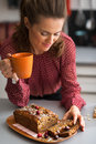 Housewife drinking tea with freshly pumpkin bread Royalty Free Stock Photo