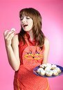 Housewife eats cookies Royalty Free Stock Photography