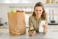 Housewife examines purchases  after shopping Royalty Free Stock Photography