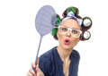 Housewife with fly swatter Royalty Free Stock Photo